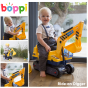 Yellow kids ride on boppi digger excavator with a toddler sitting on it indoors and playing with it